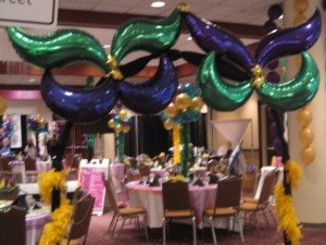 Mardi Gras balloon arch for Berts Big Adventure.