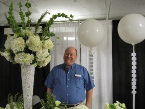 Sean Muscio of Balloonacy in Atlanta, with flowers and balloons.